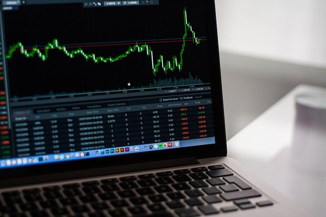 A stock chart displayed on a laptop